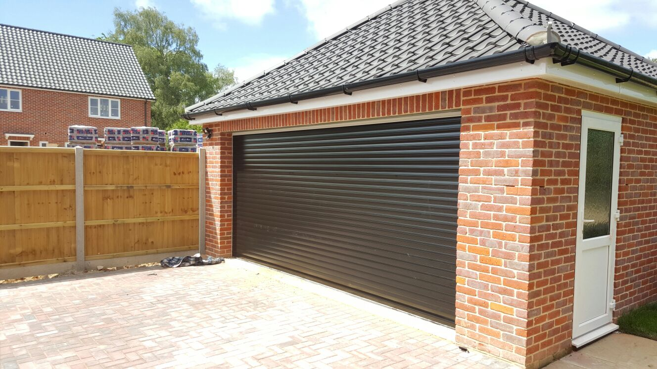 larage black roller garaged door by Rollerdor Ltd